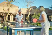 image of ping pong  - Elderly couple playing ping pong at hotel yard - JPG