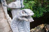stock photo of cobra  - Cobra head sculpture Am Phu Cave Danang - JPG