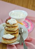 image of frizzle  - Delicious homemade pancakes with sour cream on a pink background - JPG