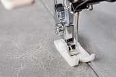 stock photo of sewing  - sewing machine makes a seam on leather - JPG