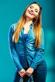 pic of denim wear  - Fashion and shopping. Smiling woman long hair wearing denim clothes. Attractive joyful girl portrait. Blue color