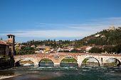picture of bridges  - The Ponte Pietra is a Roman arch bridge crossing the Adige River in Verona Italy - JPG