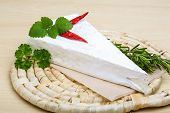 stock photo of brie cheese  - Soft brie cheese with rosemary thyme on the wood background - JPG