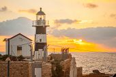stock photo of lighthouse  - The lighthouse at sunset in the old city of Acre Israel - JPG