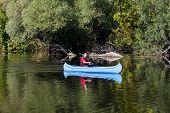 foto of canoe boat man  - View of the young man rowing in a canoe - JPG