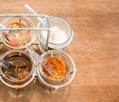 stock photo of condiment  - Thai Condiment for Noodle with Four Glasses of Ingredient - JPG