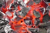 stock photo of charcoal  - Glowing Hot Charcoal Ready To Cookout Background Texture - JPG