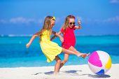 stock photo of beach-ball  - Little girls playing on beach with ball - JPG