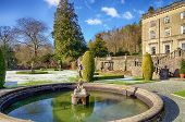 stock photo of fountain grass  - Ornamental fountain and garden of Rydal Hall on a frosty morning - JPG