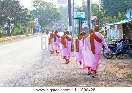MANDALAY, MYANMAR- NOVEMBER 24 :The buddhist nuns are walking along a street in city on November 24, 2015 in Mandalay,Myanmar