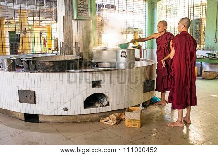 BAGO, MYANMAR -November 26, 2015: Monks preparing lunch in the monastery at Bago Myanmar. Buddhism in Myanmar is predominantly of the Theravada tradition, practised by 89% of the country's population