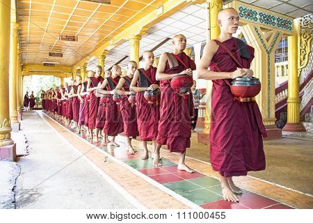 BAGO, MYANMAR -November 26, 2015: Monks going for lunch in the monastery from Bago in Myanmar.