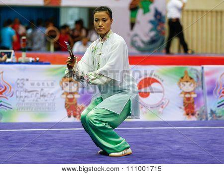 JAKARTA, INDONESIA - NOVEMBER 15, 2015: Sanatombi Leimapokpam of India performs the movements in the women's Taijijian event at the 13th World Wushu Championship 2015 held at Istora Senayan, Jakarta.
