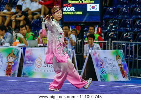 JAKARTA, INDONESIA - NOVEMBER 15, 2015: Park Minhee of South Korea performs the movements in the women's Taijijian event at the 13th World Wushu Championship 2015 held at Istora Senayan, Jakarta.