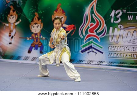 JAKARTA, INDONESIA - NOVEMBER 15, 2015: Marissa Chan of Canada performs the movements in the women's Qiangshu (spear) event at the 13th World Wushu Championship 2015 held in Istora Senayan, Jakarta.