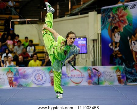 JAKARTA, INDONESIA - NOVEMBER 15, 2015: Julia Hlavata of Slovakia performs the movements in the women's Shuangjian event at the 13th World Wushu Championship 2015 held in Istora Senayan, Jakarta.