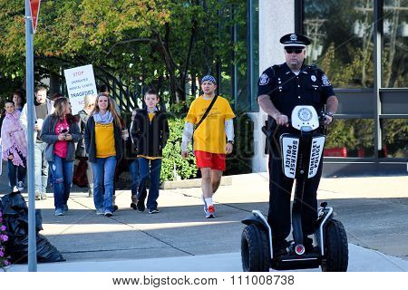 Police Officer Rides Segway During NAMI Event