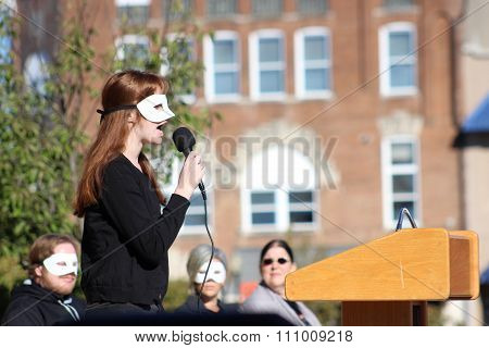 Woman With Mask Speaks at NAMI Event