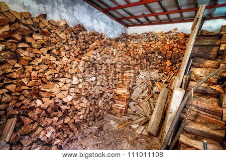 Indoor Woodshed With Nicely Arranged Chopped Firewood