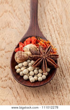 Spices In Wooden Spoon Saffron, Matrimony Vine(chinese Wolfberry),star Anise ,white Pepper With Shal