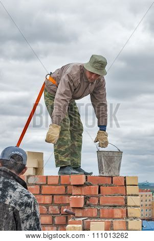 Bricklayer on house construction