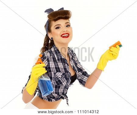 Young Woman With Spray Bottle And Sponge.