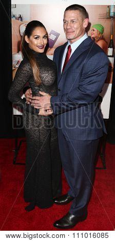 NEW YORK-DEC 8: Actor John Cena (R) and Nikki Bella attends the premiere of