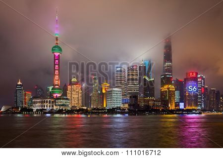 Shanghai, China - Circa September 2015: Skyline Of Shanghai In Clouds By  Night
