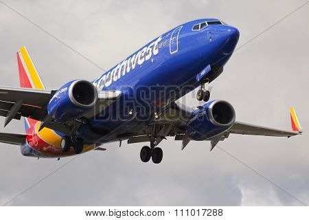 FORT LAUDERDALE, USA - JUNE 2, 2015: Southwest Airlines Boeing 737 with the new livery landing.