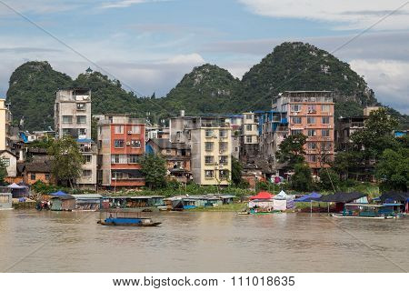 Guilin, China - Circa July 2015: Buildings And Karst Limestone Mountains Of Guilin And Li  River