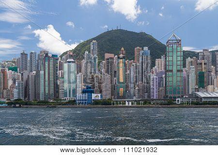 Hong Kong, Sar China - Circa July 2015: Skyline Of Hong Kong Downtown Across Victoria  Harbour