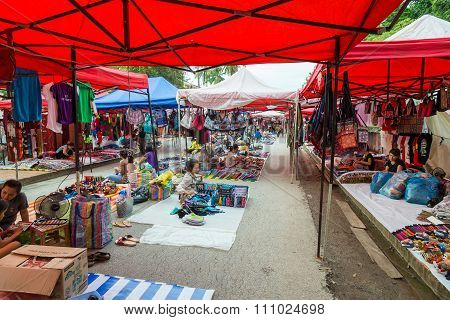 Luang Prabang, Laos - Circa August 2015: Souvenirs And Crafts Are Sold At Night Market In Luang Prab