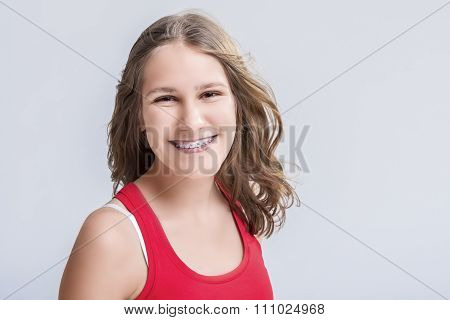 Dental And Medical Concept. Smiling Caucasian Young Blond Teenage Girl With Teeth Bracket System. Ag
