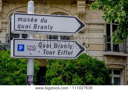 Closeup shot of sign pointing to Eiffel Tower, Paris, France