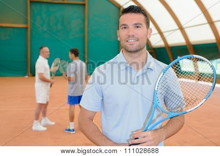 men in the tennis court