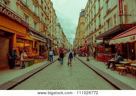 Colorful view of busy pedestrian street in Paris, France