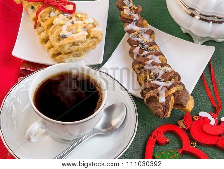 Hot Steaming Coffee And Croissants Baked In The Shape Of Christmas Tree.