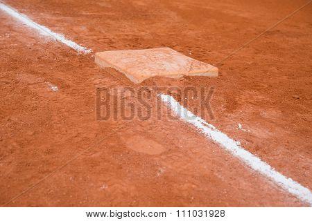 Baseball And Base On Baseball Field