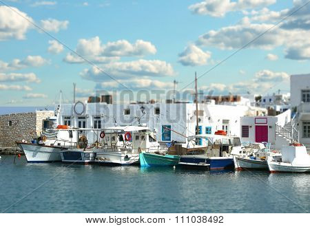 Fishing boats at the marina with tilt shift effect in Naoussa, Paros island in the cyclades, Greece