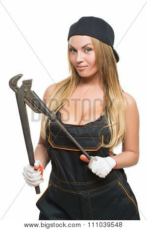 Nice sexy woman mechanic holding wrench isolated over white background