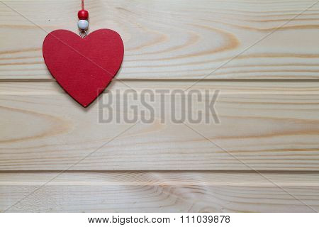 Wooden Red Heart Suspended On A Natural Wood Background.valentine Day.