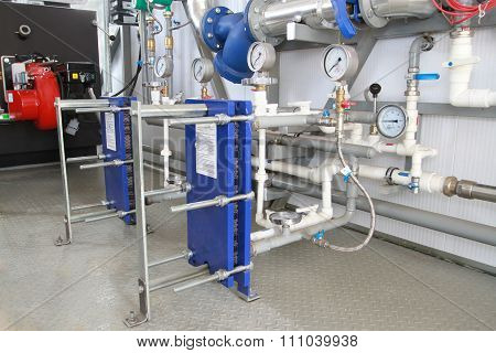Two modern heat exchangers established in a boiler-house