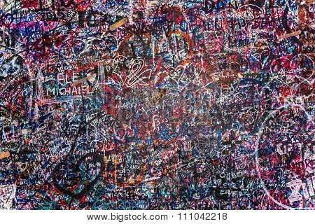 The wall full of messages from lovers in Juliet house, Verona, Italy