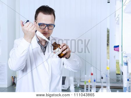 Male Scientist With Laboratory Pipettes