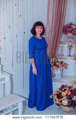Young Beautiful Woman In A Skintight Dress In Christmas Interior