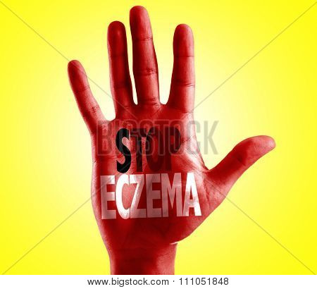 Stop Eczema written on hand with yellow background