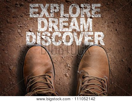 Top View of Boot on the trail with the text: Explore Dream Discover
