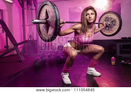 Sexy Woman Doing Squat Workout In Gym