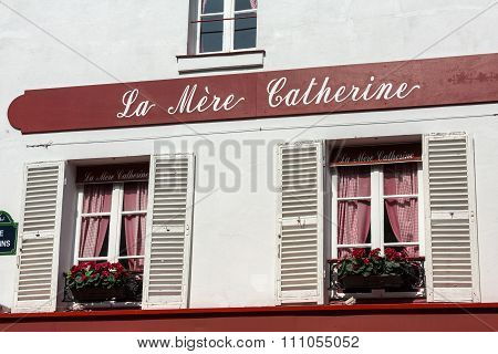 PARIS, FRANCE - SEPTEMBER 10, 2014: Montmartre - Windows with shutters of la Mere Catherine.First bistro in Paris.
