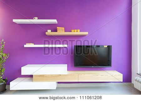 Interior of a modern living room with purple wall